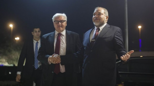 Israeli Foreign Minister Avigdor Liberman, right, shakes hands with his German counterpart Frank-Walter Steinmeier at the Foreign Ministry in Jerusalem, January13 , 2014 (photo credit: Yonatan Sindel/Flash90)