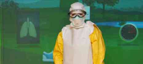 "A person stands in protective equipment at a ""Fighting Ebola Workshop."" (Photo: Ted Eytan)"