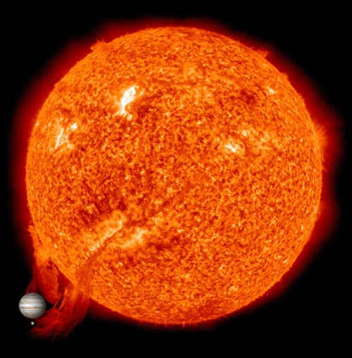 Scale model of solar prominence, Jupiter, and Earth. Image: NASA Goddard Flight Center