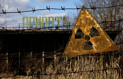 A radioactive sign hangs on barbed wire outside a cafÈ in Pripyat.